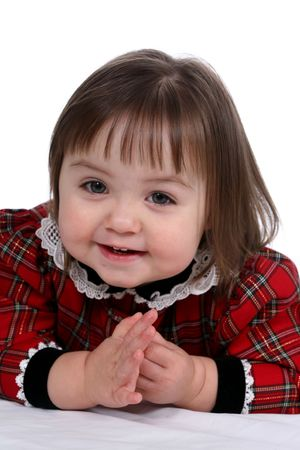 Cute little girl in red plaid dress with lace collarr photo
