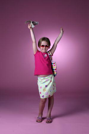 空気中のドル札を押し patterened 服かわいい若い女の子