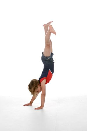 young girl doing a handstand Stock Photo