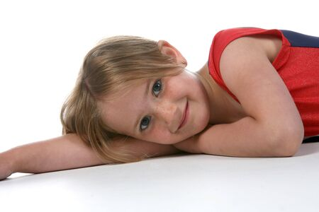 young girl with a freckled face lying on her side with one arm out stretched Stock Photo - 3209123