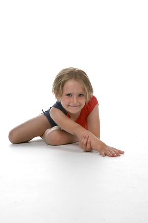 Young girl stretching her arm against a high key background