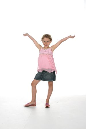 unrestrained: cute girl with arms raised as if in victory Stock Photo