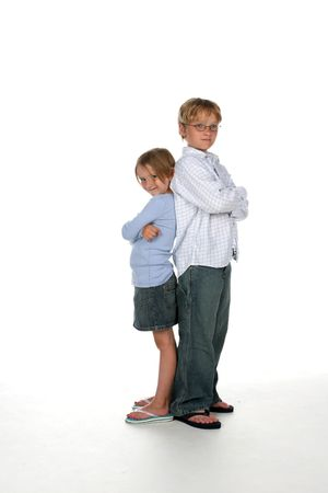 brother and sister standing back to back with their arms crossed