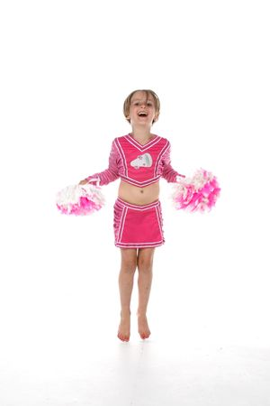 big toe: cheerleader little girl in pink with pointed toes Stock Photo