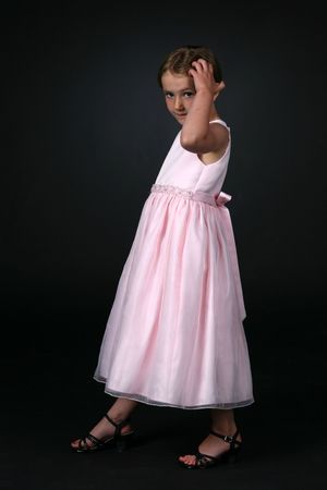 pretty girl in pink dress, touching her hair Reklamní fotografie - 3227441