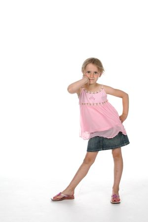 lean out: cute girl standing with hip pushed out and elbows bent.