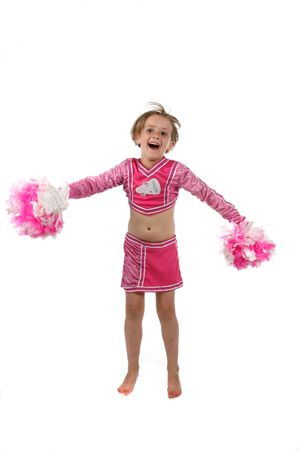 cute girl doing a cheering routine in a pink outfit and pom poms photo