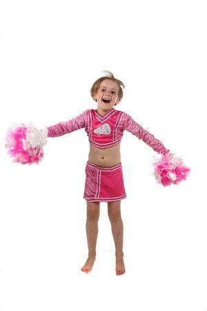 schattig meisje doet een gejuich routine in een roze outfit en POM poms