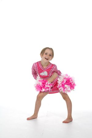 pom poms: cheerleader little girl in pink outfit and pom poms Stock Photo