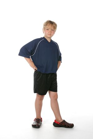 Handsome young boy with his hands on his hips Stock Photo