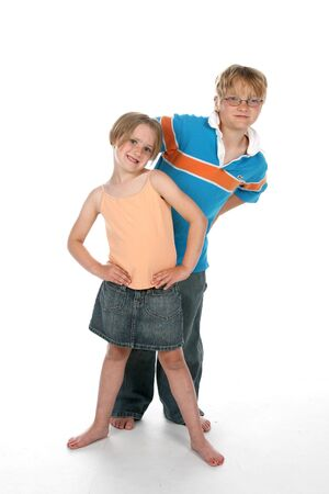 brother and sister standing on a high key background together Stock Photo - 3239509