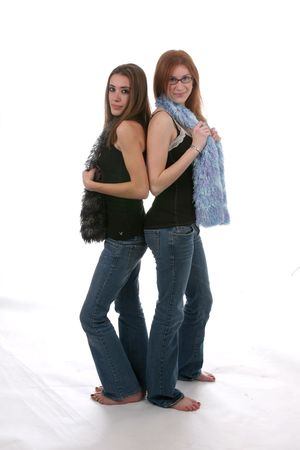 tough: Pretty teenage girls in tight jeans and scarfs Stock Photo