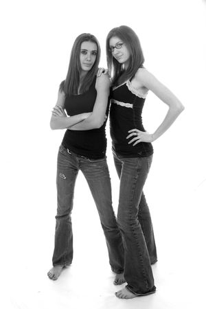 pretty slender teenage girls in tight denim and bare feet photo