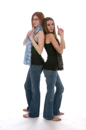 tight jeans: edgy looking teens with tight denim and fuzzy scarfs Stock Photo