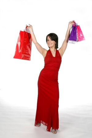 Pretty teen in red gown with shopping bags