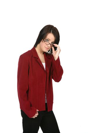 young woman in business casual attire, looking over the top of her glasses photo