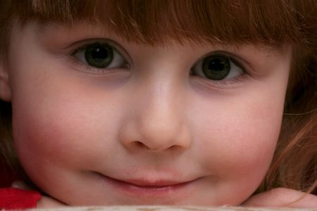 close up of pretty little girls face with big eyes