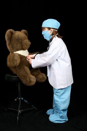 doctoring: Bambina medica scrub doctoring orsacchiotto  Archivio Fotografico