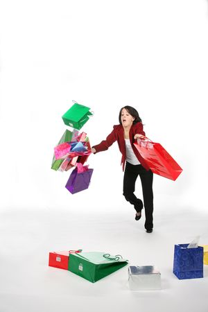 teenage girl falling down with shopping bags and boxes photo