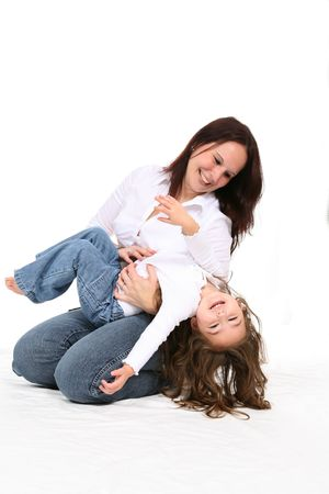 family tickle: mother tickling her toddler girl Stock Photo