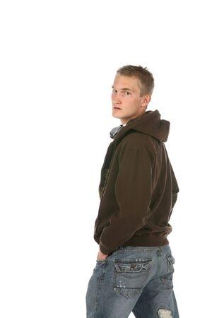 young man in hooded sweatshirt Stock Photo