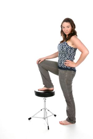 stool: woman standing with one foot on stool Stock Photo