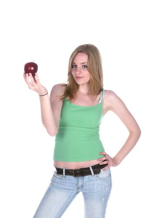 pretty woman in green holding a red apple Banco de Imagens