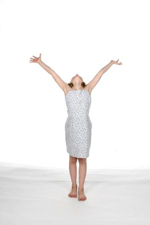 girl in dress with arms up in excitement or praise or victory