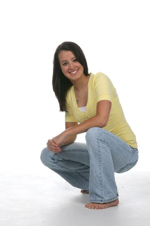 knees bent: pretty teenage girl bent at the knees and smiling