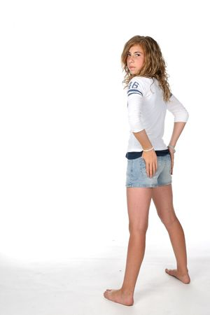 young girl in shorts with hands on hips