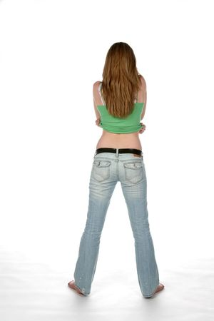 back straight: sexy woman from behind, lifting her shirt Stock Photo
