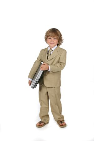 young boy in tan suit holding laptop under his arm Standard-Bild