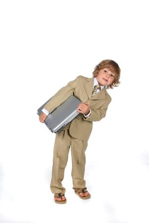 prodigy: young boy with laptop and wearing a suit Stock Photo