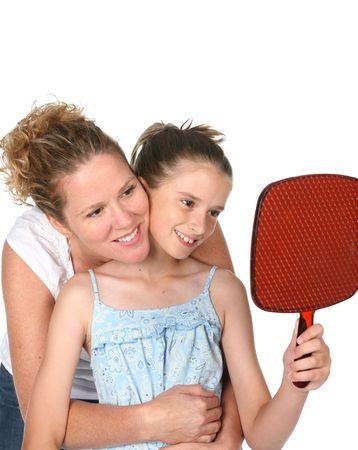 母と娘の鏡を見る 写真素材