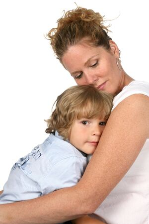 instinct: mother with her eyes closed and holding son close Stock Photo