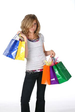 pre teen girl with shopping bags 写真素材