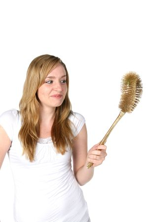 humor: pretty woman with golden toilet brush  Stock Photo