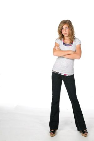 girl standing with arms crossed and pouting photo