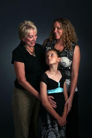 three generations: studio portrait of three generations of women