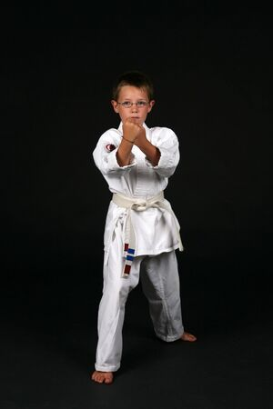 young boy in traditional karate right stance