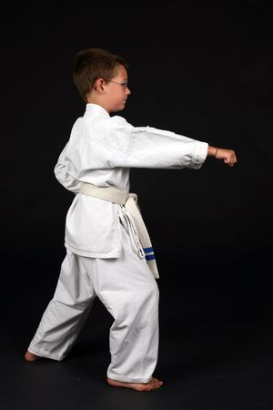 demonstrating: young boy demonstrating traditional karate right stance