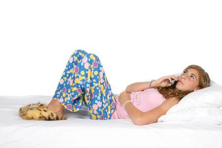 Niña en pijama y zapatillas hablando por el teléfono Foto de archivo - 3493425