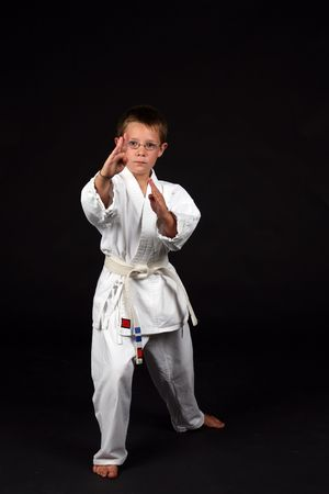 demonstrating: traditional karate student demonstrating handblock and right stance Stock Photo