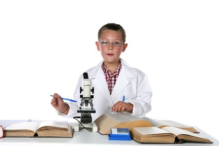 young scientist consulting his books and holding a pen photo