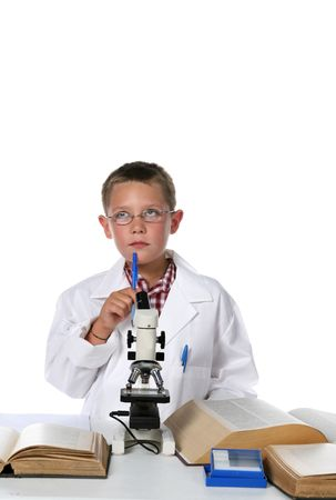 young scientist putting his pen to his chin while thinking out a solution to his problem photo