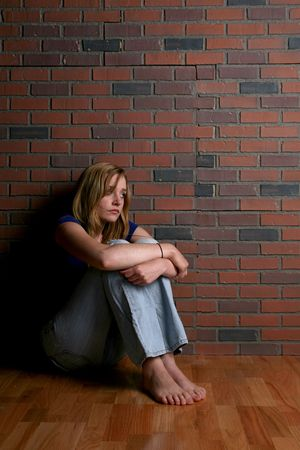 woman sitting alone depicting mental health concept of depression Stock Photo