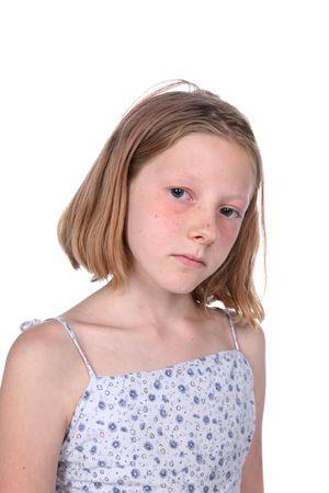 freckled girl looking sad; high key studio portrait