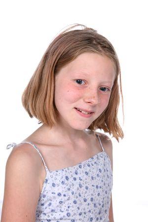 freckled little girl with short straight hair smiling Banco de Imagens