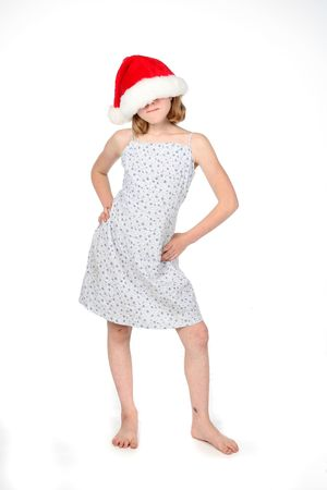 young girl with a santa hat over her face