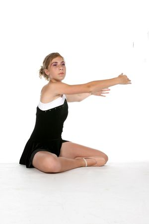 lean out: young ballerina with arms extended; high key studio portrait